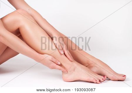 Ankle Pain. Female Legs. Woman Massaging Her Ankle