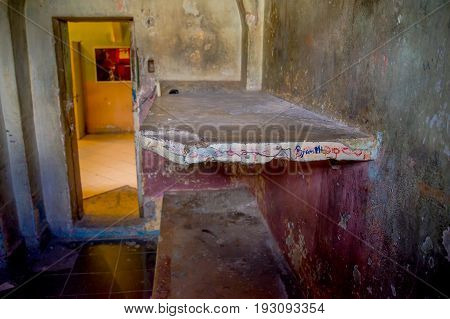 Indoor view of stoned bed in the room of the prisioners, in the old prison Penal Garcia Moreno in the city of Quito.