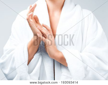 Closeup Beautiful Woman After Bath In White Bathrobe
