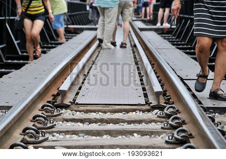 Railroad, Railway, concept with tourists walking background