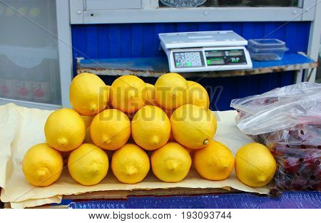 Lemons in the market, weighing shop weighing