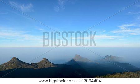 Majestic panoramic view of the pyramid shadow from the Adam's Peak (Sri Pada Mountain) Sri Lanka