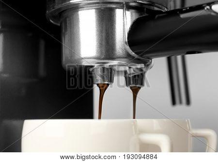 Closeup of making aromatic espresso in coffee machine