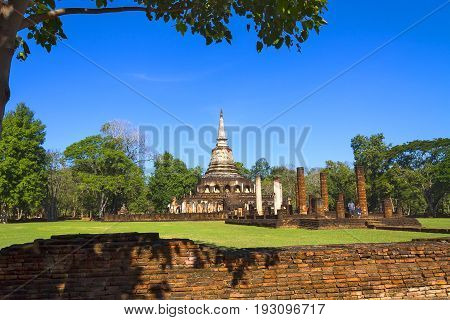 Wat Chang Lom temple and blue sky in Sisatchanalai Historical Park Sukhothai province Thailand