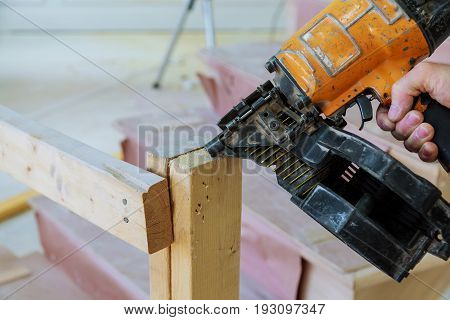 Gun Construction Shoot The Nails In The Wooden Wall