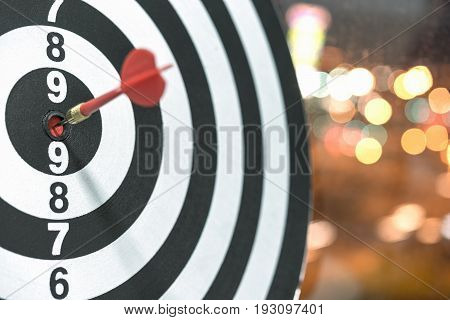 Red dart target arrow hitting on bullseye with bokeh background Accuracy business success concept