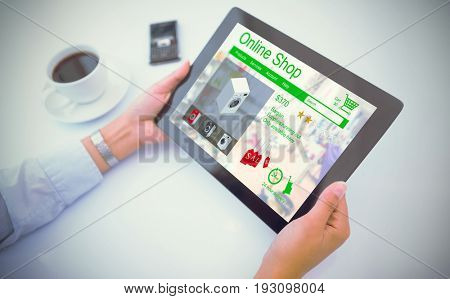 Man using tablet pc against washing machines for sale displayed on web page