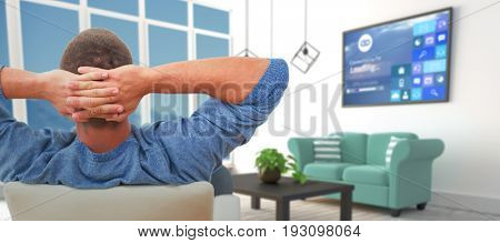 Rear view of busnessman relaxing on chair against blue sofas in modern living room