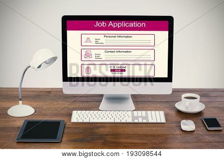 Digitally generated image of Job Application  against computer with digital tablet and mobile phone on desk