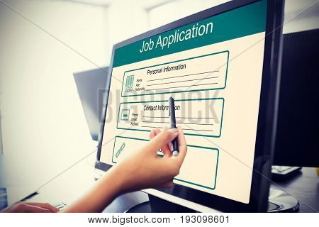 Digitally generated image of Job Application  against  casual businesswoman touching her computer  Casual businesswoman touching her computer with a pen