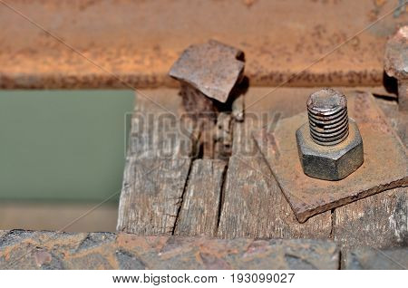Big rusty metal nut locked with rust and corrosion bolt, Industrial bolt and nut with shallow focus