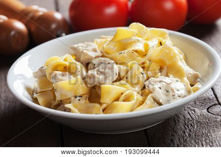 Italian chicken alfredo, pappardelle pasta in cream and cheese sauce