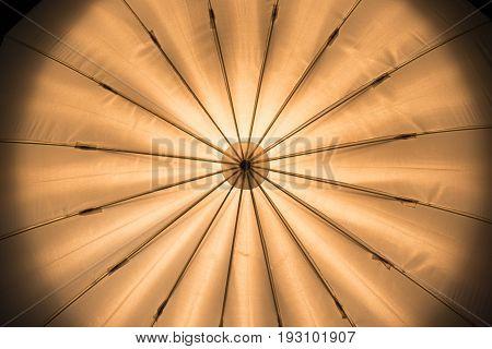 Umbrella Lighting abstract with warm light in photo studio.