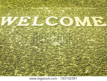 Welcome on dark green texture background floor mat