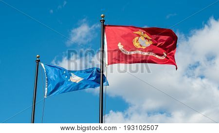 U.S. Air Force and U.S. Marine Corps Flags Blow in the Wind
