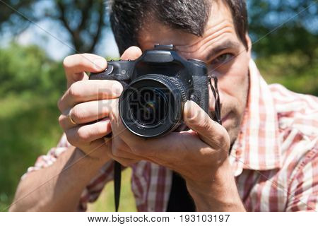 Man Photographer With Camera In Nature