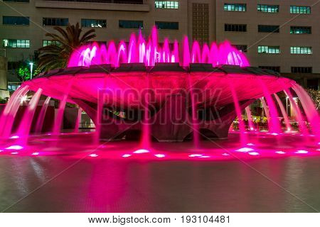 LOS ANGELES, CALIFORNIA - FEBRUARY 19, 2017:  The Arthur J. Will Memorial Fountain in Grand Park with pink LED lights showing in its synchronized water show.