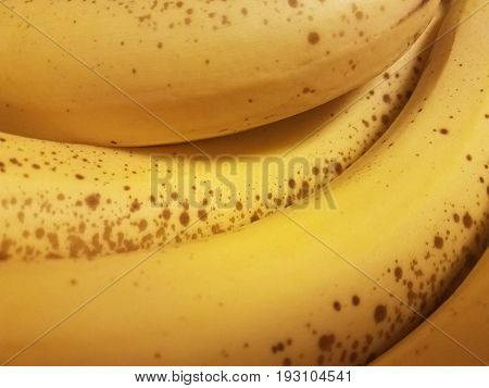 a bunch of yellow ripe bannanas with brown spots