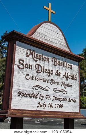 SAN DIEGO, CALIFORNIA - JUNE 24, 2017:  Sign for Mission Basilica San Diego de Alcala, the first Franciscan mission in The Californias, founded on July 16, 1769 by Spanish friar Junipero Serra.