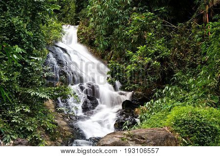 a cascade of water falling from a height, formed when a river or stream flows over a precipice or steep incline
