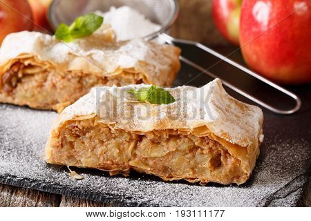 Austrian Food: Apple Strudel With Powdered Sugar And Mint Macro On The Table. Horizontal