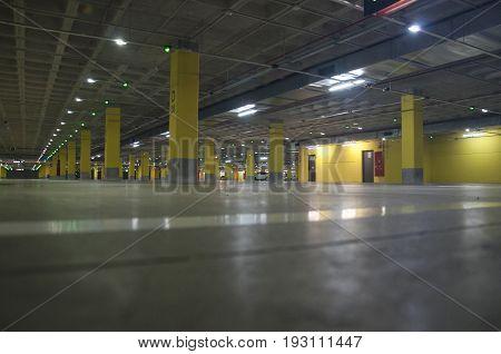 Almost empty car park lot below a mall