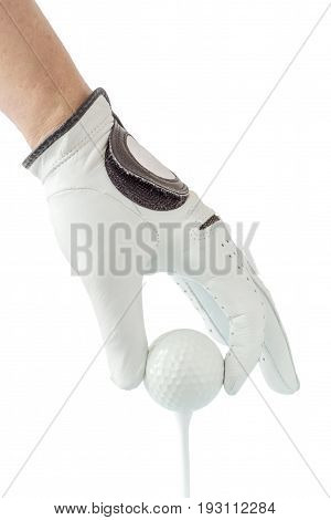 Close up the golfer hand in glove holding the golf ball with tee ready to start the golf game.