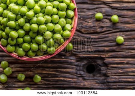 Peas. Fresh bio homemade peas and pods on old oak board. Healthy fresh green vegetable - peas and pods.