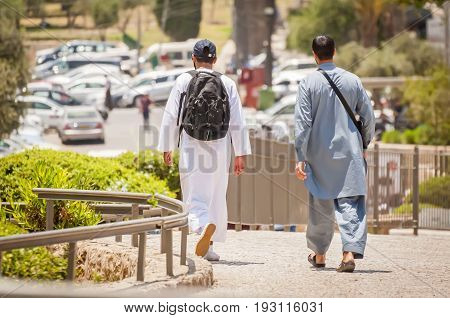 JERUSALEM, ISRAEL. June 20, 2017. Two young Muslim tourists walking on the streets of Jerusalem by the Damascus gate of the Old city.