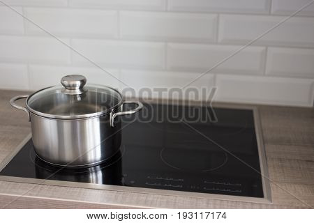 Metal Pot On Electric Stove In Kitchen