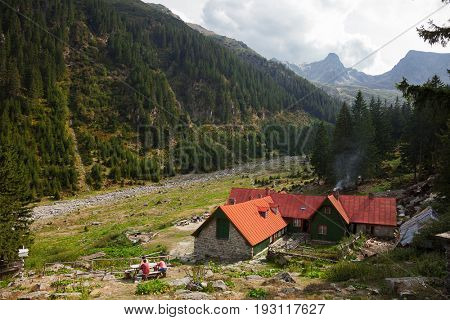 Landscape in the Carpathian mountains with traditional old mountain chalet