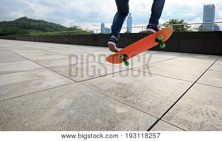 closeup of one young skateboarder practice skateboarding outdoor
