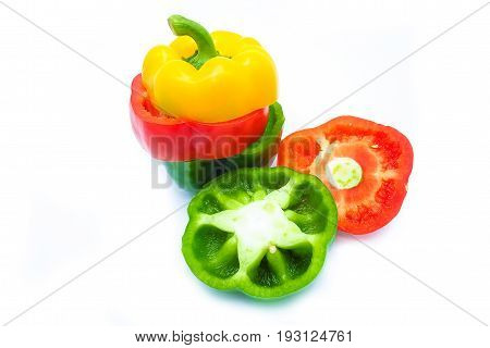 Bell Pepper Is Sliced In Three Colors, Isolated On A White Background