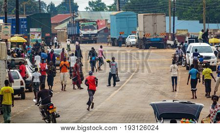 UGANDA - AUGUST 8: Unidentified people walk along the road through the city Uganda on August 8, 2016 in Uganda