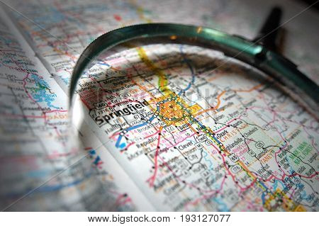 A magnifying glass over a map of Springfield, Missouri.