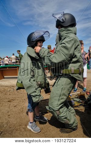 Visitors Of Show Try On The Sapper Suit