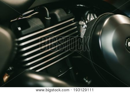 Close up view of a shiny black motorcycle engine. Motor bike detail