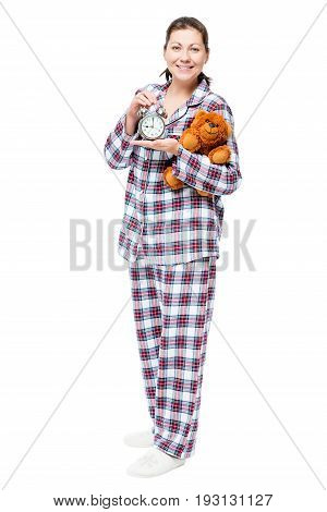 In Full Length Happy Woman In Pajamas With An Alarm Clock And Toy On A White Background