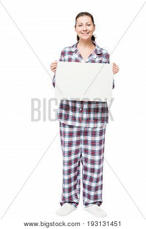Brunette 30 Years In Pajamas In Full Length With An Empty Poster On A White Background