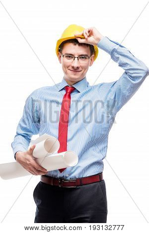 Architect With Drawings Corrects His Hand With A Yellow Helmet On His Head Isolated