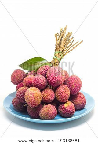 fresh fruit lychee on blue ceramic tableware on white background