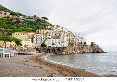 A couple has the whole beach to themselves on a stormy overcast autumn day - Amalfi, Campania, Italy, 27 October 2011
