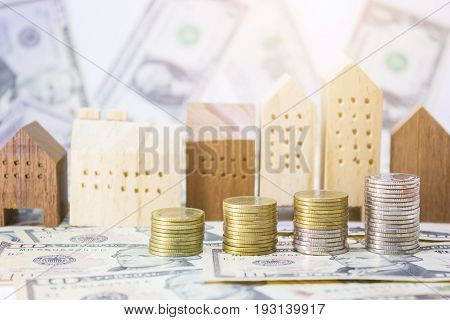 coins home model with banknotes dollar for realestate business and financial concept.