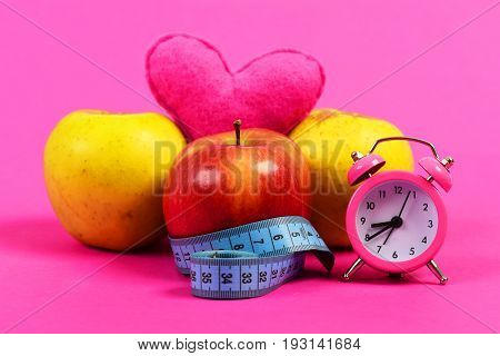 Set Of Red And Yellow Apples Wrapped With Measuring Tape