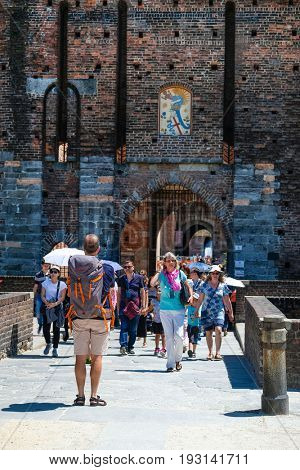 Milan, Italy - June, 19, 2017: tourists on the entrance of Milan castle in Milan, Italy
