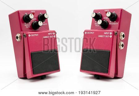 Red vintage guitar pedal isolated on white background