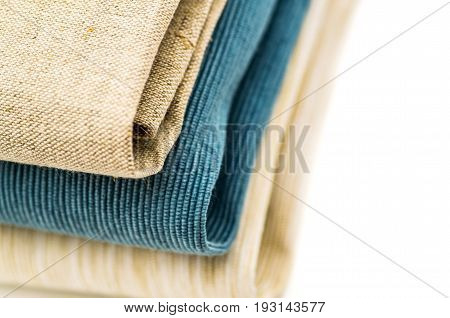 three linen table clothes on white background
