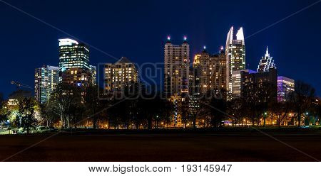 Dusk view of illuminated skyscrapers of Midtown Atlanta from the Piedmont Park USA