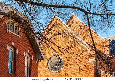 Part of brick facade of Catholic Shrine of the Immaculate Conception in sunny autumn day Atlanta USA