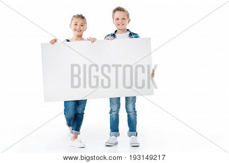 Cute Little Children Holding Blank Banner And Smiling At Camera
